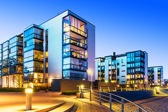 Real Estate Syndications vs. Investing Solo: An Analysis
